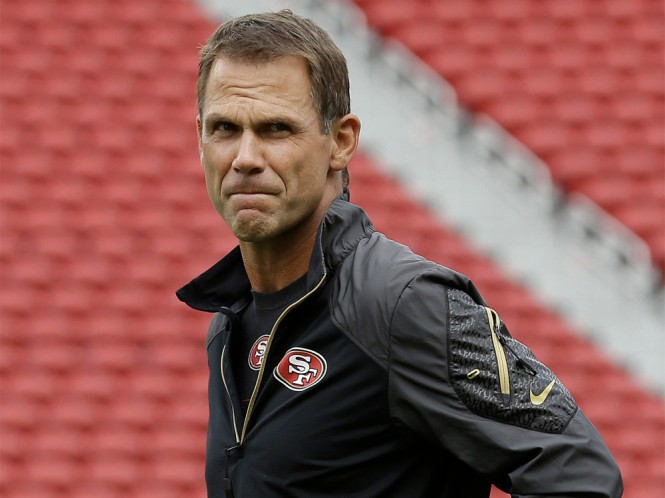 San Francisco 49ers general manager Trent Baalke watches as players practice during an NFL football mini-camp in Santa Clara, Calif., Tuesday, June 9, 2015. (AP Photo/Jeff Chiu)
